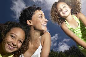 mom and daughters happy